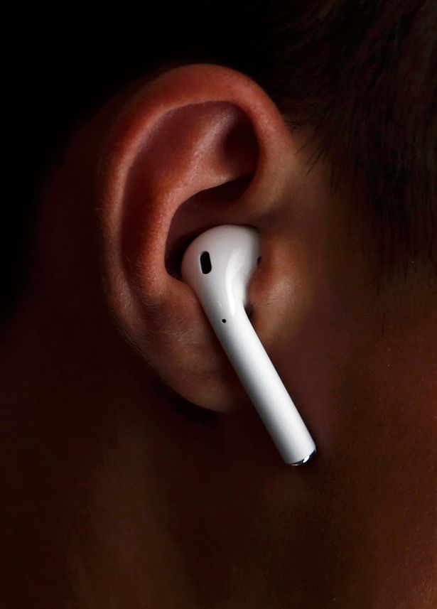 an-attendee-wears-the-apple-airpods-during-an-apple-media-event-in-san-francisco