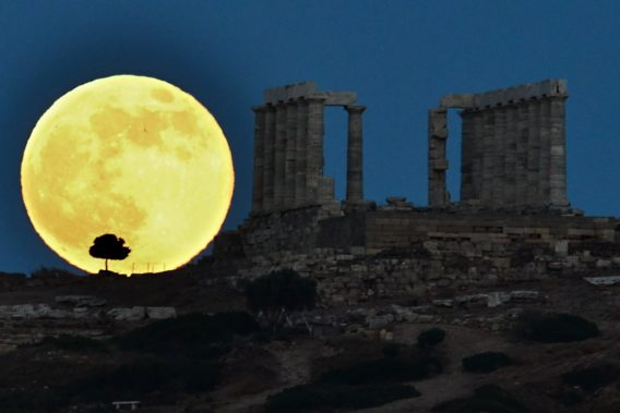 A supermoon rises next to the ancient Greek temple of Poseidon at Cape Sounion, some 65 kilometers south of Athens, on June 23, 2013. AFP PHOTO / ARIS MESSINIS (Photo credit should read ARIS MESSINIS/AFP/Getty Images)